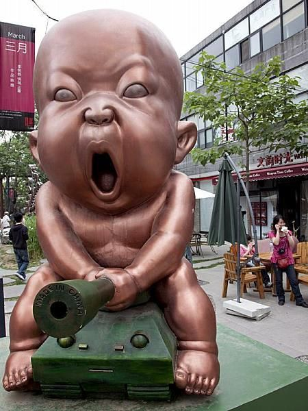 giant baby on a cannon statue